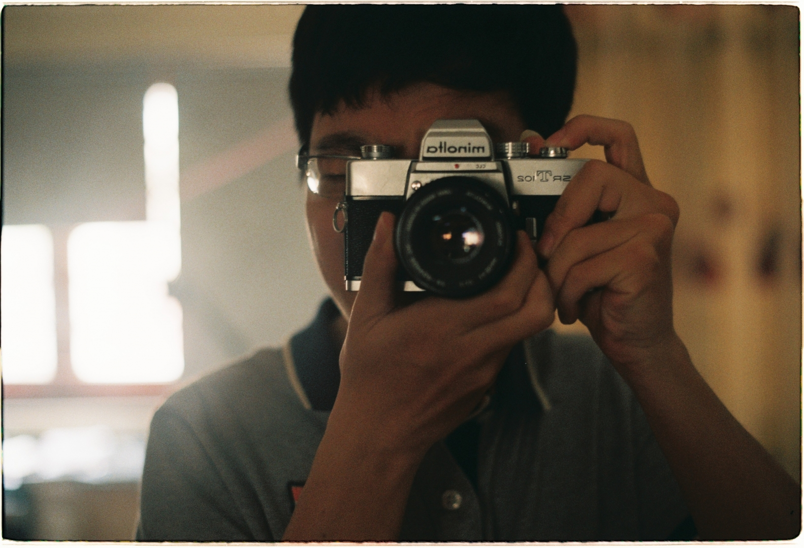 Self-portrait with Minolta SRT-102